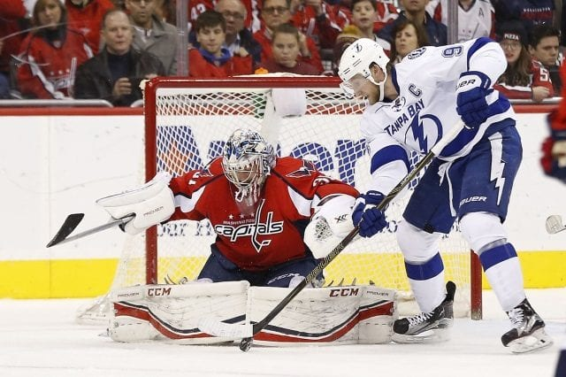 Steven Stamkos of the Tampa Bay Lightning and Phillip Grubauer of the Washington Capitals