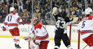Eddie Lack of the Carolina Hurricanes and Conor Sheary of the Pittsburgh Penguins