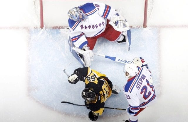 Henrik Lundqvist of the New York Rangers and Carl Hagelin of the Pittsburgh Penguins
