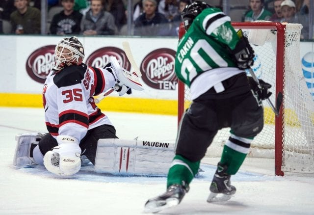 Cory Schneider of the New Jersey Devils and Cody Eakin of the Dallas Stars