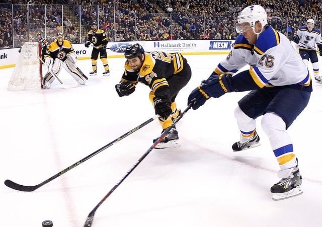 Adam McQuaid of the Boston Bruins and Paul Stastny of the St. Louis Blues