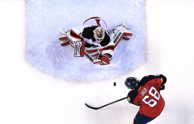 Keith Kindaid of the New Jersey Devils and Jaromir Jagr of the Florida Panthers