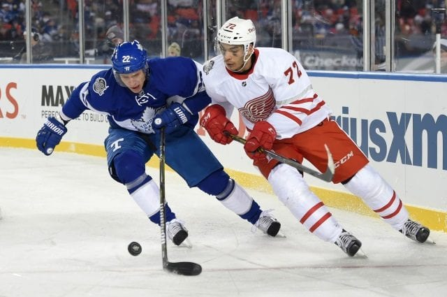 Nikita Zaitsev of the Toronto Maple Leafs and Andreas Athanisiou of the Detroit Red Wings
