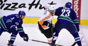 Wayne Simmonds of the Philadelphia Flyers and Alex Edler of the Vancouver Canucks