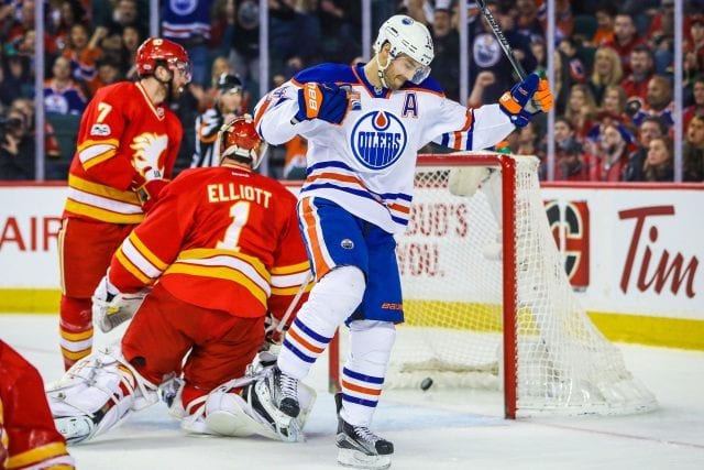 Edmonton Oilers forward Jordan Eberle scoring on Calgary Flames goalie Brian Elliott