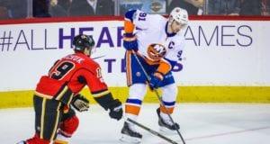 John Tavares of the New York Islanders and Mathew Tkachuk of the Calgary Flames