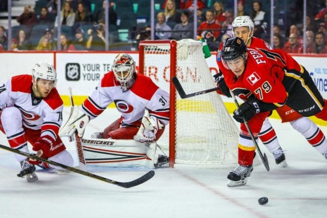 The Carolina Hurricane trade Eddie Lack and Ryan Murphy to the Calgary Flames