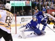 David Pastrnak of the Boston Bruins and Frederik Andersen of the Toronto Maple Leafs