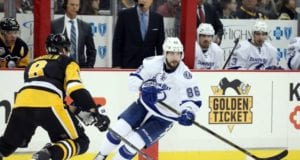 Nikita Kucherov of the Tampa Bay Lightning and Brian Dumoulin of the Pittsburgh Penguins