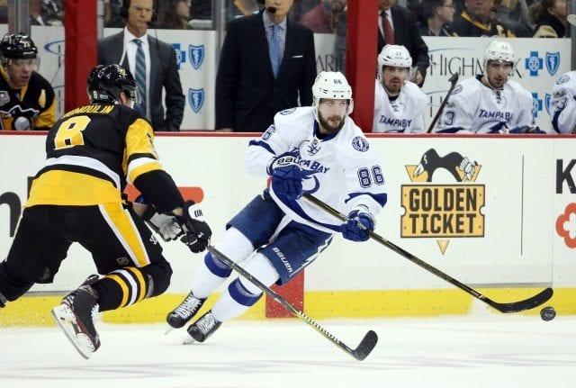 Nikita Kucherov of the Tampa Bay Lightning and Brian Dumoulin of the Pittsburgh Penguins
