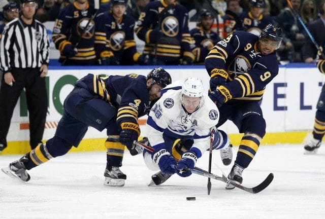 Evander Kane of the Buffalo Sabres and Ondrej Palat of the Tampa Bay Lightning