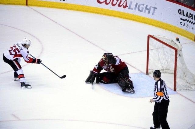 Erik Karlsson of the Ottawa Senators and Mike Smith of the Arizona Coyotes