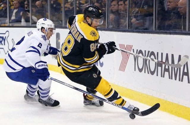 David Pastrnak of the Boston Bruins and Matt Hunwick of the Toronto Maple Leafs