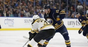 Jack Eichel of the Buffalo Sabres and Patrice Bergeron of the Boston Bruins