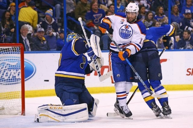Patrick Maroon of the Edmonton Oilers and Carter Hutton of the St. Louis Blues