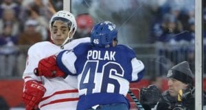 Andreas Athanasiou of the Detroit Red Wings and Roman Polak of the Toronto Maple Leafs