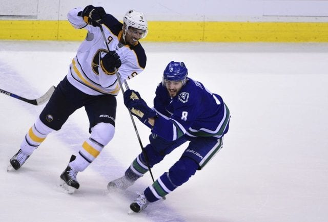 Evander Kane of the Buffalo Sabres and Chris Tanev of the Vancouver Canucks
