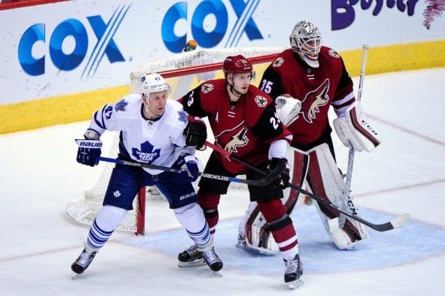 Oliver Ekman-Larsson of the Arizona Coyotes and Leo Komarov of the Toronto Maple Leafs