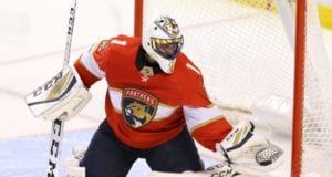 Florida Panthers goalie Roberto Luongo helped off the ice with a lower-body injury