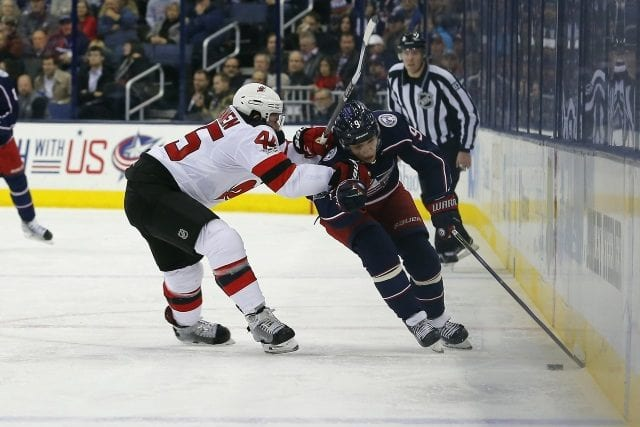 Artemi Panarin of the Columbus Blue Jackets and Sami Vatanen of the New Jersey Devils