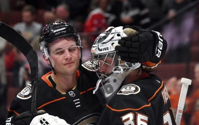 Cam Fowler and John Gibson