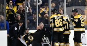 Boston Bruins defenseman Brandon Carlo stretchered off with a leg injury.