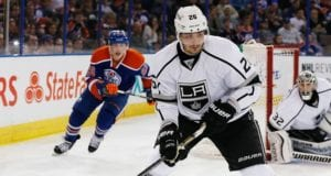 Slava Voynov of the Los Angeles Kings and Ryan Nugent-Hopkins of the Edmonton Oilers