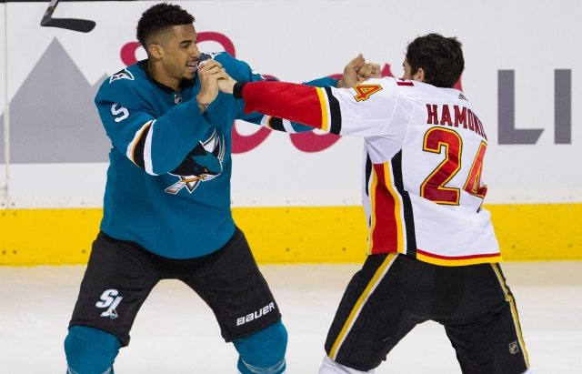 NHL free agent signing analysis of Evander Kane's seven-year contract extension with the San Jose Sharks.