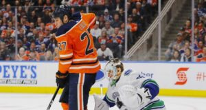 Edmonton Oilers winger Milan Lucic and Vancouver Canucks goaltender Jacob Markstrom