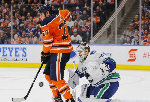 Edmonton Oilers winger Milan Lucic and Vancouver Canucks goaltender Jacob Markstrom
