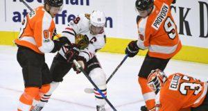 Philadelphia Flyers defenseman against Jonathan Toews of the Chicago Blackhawks