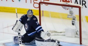Connor Hellebuyck and the Winnipeg Jets agree on a six-year contract extension.