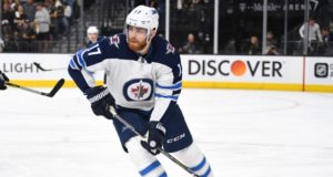 The Winnipeg Jets have signed Adam Lowry to a three-year contract.