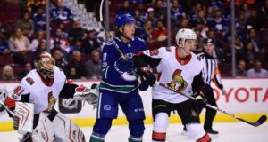 Ottawa Senators goaltender Craig Anderson and Vancouver Canucks forward Jake Virtanen.