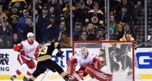 Jimmy Howard of the Detroit Red Wings and Brad Marchand of the Boston Bruins