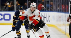 The Calgary Flames trade Hunter Shinkaruk to the Montreal Canadiens for Kerby Rychel.