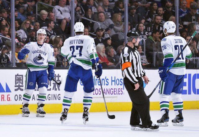 Vancouver Canucks Ben Hutton and Nikolay Goldobin