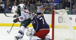 Columbus Blue Jackets goaltender Sergei Bobrovsky and Minnesota Wild forward Eric Staal