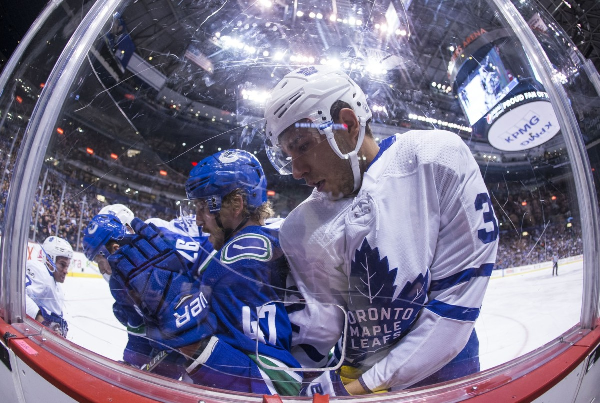 Toronto Maple Leafs trade forward Leivo to Vancouver Canucks for forward Carcone