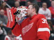 Detroit Red Wings goaltender injures his back in warmups.