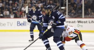 Winnipeg Jets Dustin Byfuglien practices in a regular jersey.