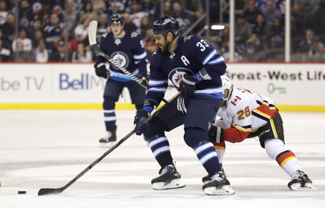 Winnipeg Jets Dustin Byfuglien practices in a regular jersey.