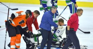Vancouver Canucks Alex Edler gets stretchered off after hitting his face on the ice.