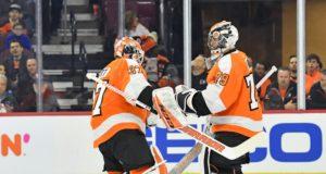 Philadelphia Flyers goaltenders Carter Hart and Brian Elliott