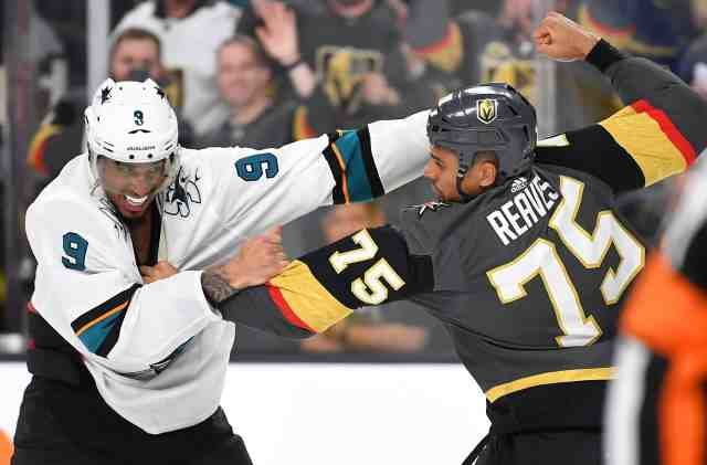 Ryan Reaves and Evander Kane drop the mitts.