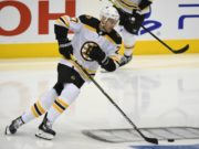 Boston Bruins defenseman John Moore isn't playing at a 100 percent