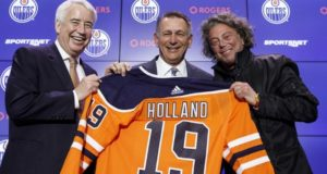 NHL-Oilers-Holland-poses-at-press-conference-1040×572