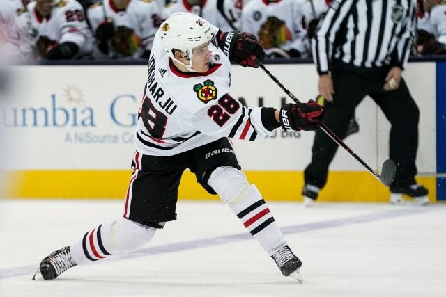 The Chicago Blackhawks have traded defenseman Henri Jokiharju to the Buffalo Sabres for forward Alex Nylander.