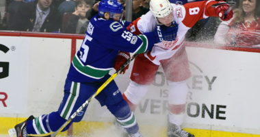 The Vancouver Canucks have traded Alex Biega to the Detroit Red Wings.
