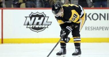 Penguins Jake Guentzel crashes awkwardly into the boards.